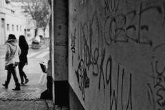 Graffiti in the city (Nikon FM3A) (stefankamert) Tags: street city people blackandwhite bw film analog graffiti blackwhite nikon dof grain xp2 sw fm ilford fm3a schwarzweis seriese stefankamert
