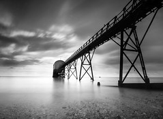 Glowing (HannahGE) Tags: uk longexposure sea white mist motion black blur beach water station sussex mono pier movement smooth lifeboat kelsey rnli