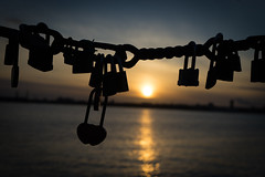Love Lock Sunset (MikeBish) Tags: sunset love water silhouette liverpool river chains waterfront sundown silhouettes locks mersey lovelock rivermersey flickrfriday