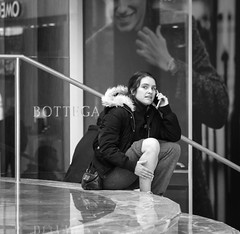 Bottega (John St John Photography) Tags: blackandwhite bw woman blackwhite hands phone interior worldtradecenter steps streetphotography indoor smartphone wintergarden marble youngwoman worldfinancialcenter candidphotography bottega eddieredmayne brookfieldplace