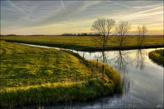 At the end of a lovely day (Hetty S.) Tags: trees sunset sky holland water colors canon reflections landscape eos spring meadows alkmaar hdr