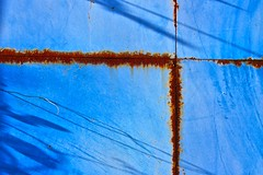 Golden rule of thirds (Andrea Kennard) Tags: blue light shadow sky abstract lines metal facade rust iron industrial estate background grunge bricks curves diagonal shade half walls corrugated enfield serrated