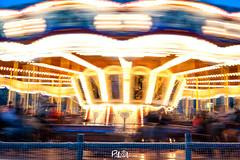 Nunca digas nunca, la vida da muchas vueltas y va demasiado rpido. (Pili Oliva) Tags: luces movimiento tiovivo carrusel