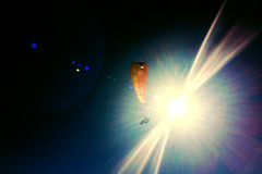 Partial eclipse (Melissa Maples) Tags: cameraphone blue winter sky apple turkey asia trkiye antalya lensflare flare paragliding paragliders parachute sunflare iphone  iphone6