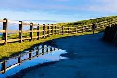 Walking along the Cliffs of Moher (Kuba Abramowicz) Tags: blue ireland sky cliff color colour reflection water colors composition fence reflections landscape puddle golden nikon clare colours outdoor doolin landmark cliffs reflect nikkor moher goldenhour refelction d610 2470 nikor