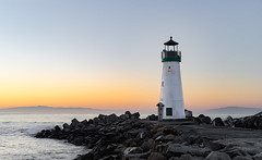 Walton Lighthouse (paulius.dragunas) Tags: california morning travel santacruz lighthouse nature sunrise pier rocks calm adventure