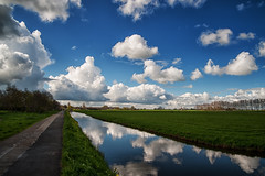 Clouds over Mijdrecht, April 17th 2016 (PaulHoo) Tags: sky holland reflection nature water netherlands lines clouds landscape peaceful nik polarizer 2016 mijdrecht colorefex