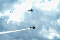 Two vintage WWII aircraft simulate a dogfight at the 2014 Air Show of the Cascades near Madras, Oregon. (mharrsch) Tags: oregon vintage airplane aircraft aviation wwii madras airshow mharrsch airshowofthecascades