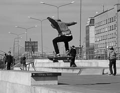 Short moment of flight (mkorolkov) Tags: street city urban blackandwhite monochrome jump skateboarding flight streetphotography skate skateboard fujifilm skater xe1 xc50230