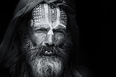 Sadhu Series, ONE (Axel Halbgebauer) Tags: street nepal portrait blackandwhite bw black face closeup blackbackground contrast zeiss dark beard temple prime blackwhite eyes asia head expression sony teeth religion streetphotography headshot hindu hinduism sadhu holyman southasia saarc sonyalpha streetportait sonnar13518za sonyimages