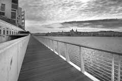 Vanishing Point (albireo 2006) Tags: sea blackandwhite bw water clouds vanishingpoint blackwhite cloudy perspective malta pb nb bn boardwalk railing passage pathway sliema valletta blackandwhitephotos blackwhitephotos