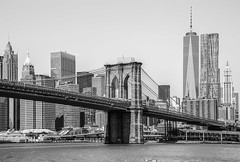 Black and White Brooklyn Bridge Manhattan Cityscape (12bluros) Tags: city nyc newyorkcity travel bridge urban blackandwhite usa tower skyline architecture buildings river downtown cityscape waterfront unitedstates manhattan worldtradecenter shoreline historic brooklynbridge eastriver 1001nights suspensionbridge lowermanhattan skyscapers nationalhistoriclandmark riverscape freedomtower newyorkcitylandmark 5photosaday manhattannewyork canonef24105mmf4lisusm oneworldtradecenter 1001nightsmagiccity