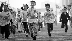 Colours of Emotions, Colours of Happiness (Rahul Gaywala) Tags: india white black monochrome smile kids race canon children fun happy child sad marathon joy run laugh cry tear excitement tamron sorrow abuse gujarat surat 70300 5dm3
