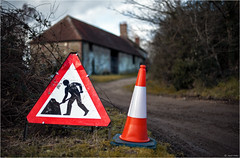 Man with Umbrella (Robots are Stupid) Tags: road uk greatbritain red england orange sign barn rural umbrella work warning rouge sussex dof westsussex cone unitedkingdom britain roadworks farm menatwork caution signage roadsign signpost roadside scratched brolly southdowns cones 50mmf14 warningsign trafficcone midhurst shallowdepthoffield shallowdof britishcountryside redford witcheshat highwaycode roadcone roadcones 50mmnikkor ruralengland ruralsussex d700 woolbeding ruralbritain nikond700 sussexcountryside southdownsnationalpark poundcommon woolbedingcommon daviddalley davidjdalley linchroad poundcommoncottages