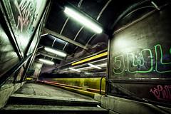 don't be afraid of the dark (Blende57) Tags: city urban motion bus night speed dark concrete darkness wideangle busstop motionblur transportation lighttrails