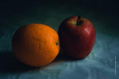 odd couple (imagomagia) Tags: orange apple fruit sweden naturallight stillife complentarycolors