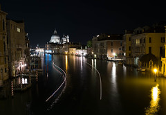 View of the Grand Canal in Venice at night with Santa Maria della Salute bathed in lights and water taxi streaming lights (Jean-Pierre Dery) Tags: santa city travel bridge cruise pink blue venice summer vacation italy house black tower history tourism church nature water yellow architecture night lights boat canal italian colorful europe european cityscape place natural bell maria famous salute transport grand landmark palace tourist architectural campanile romantic historical venetian laguna venezia renaissance watertaxi touristic