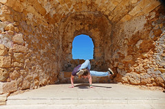 Framed- Chania, Crete (Flortography) Tags: blue woman yoga lady pose person framed inversion shape fortress armbalance