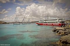 Blue Lagoon, Comino (Malta) (mariasammut987) Tags: blue sea clouds outdoors rocks lagoon swimmer yachts captainmorgan