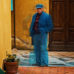 man in blue on a background of yellow wall (A.Gutkin) Tags: italy art pienza  artofimages