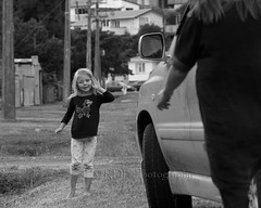Saying Goodbye  2 (C & R Driver-Burgess) Tags: street door blackandwhite bw girl monochrome car leaving jumping waiting child open small mother mum blonde parked gutter