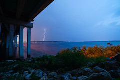 Nature's Fury (+Lonnie & Lou+) Tags: longexposure travel bridge blue sky usa lake nature water rain america day florida sony jacksonville lightning tennant a7r
