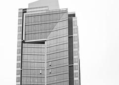 New Condo's Cloudy Morning (Orbmiser) Tags: bw building oregon skyscraper portland spring nikon raindrops condos raining d90 55200vr