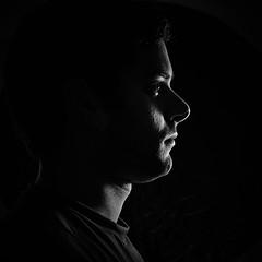 profil portrait (CHCaptures) Tags: portrait white man black monochrome face dark blackwhite gesicht sony side flash profile mann blitz lowkey schwarz metz dunkel profil hintergrund seite backround weis schwarzweis sal50f18 slta58