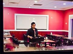 Last table of the night. (TheeErin) Tags: red people newyork night work table observation person restaurant nightshot candid empty working indoor tables walkby bussing vouyer walkbyshootings wingwan busingtables