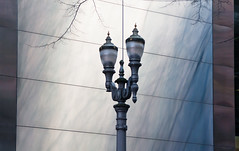 Lamp Post Against the Stainless (Orbmiser) Tags: winter building metal oregon portland nikon streetlight lamppost stainless d90 55200vr