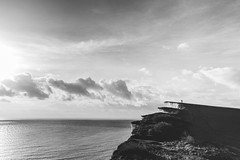 Man on a Cliff (craigmdennis) Tags: ocean sea sky cliff water danger landscape blackwhite edge