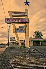 HOLIDAY MOTEL (akahawkeyefan) Tags: holiday sign junk motel fresno ugliness depressing davemeyer