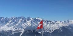 Get the Alpine look (akerrz) Tags: winter red mountain snow switzerland flag peak bluesky piste verbier
