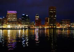 Light City Baltimore (` Toshio ') Tags: city usa reflection night america buildings downtown cityscape skyscrapers maryland baltimore toshio lightcity xe2 fujixe2