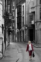 Woman in red (ramosblancor) Tags: travel blackandwhite woman streets blancoynegro mujer rojo cities asturias villages ciudades blonde rubia balconies pueblos llanes humans calles viajar humanos balcones inred blondeinred