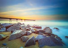 Dawn at the Gas Bridge (David Martn Lpez) Tags: longexposure bridge sea seascape sunrise landscape puente dawn mar sand rocks stones silk paisaje arena amanecer le seda hitech rocas piedras badalona largaexposicion pontdelpetroli lucroit puentedelpetrolio davidmartinlopez