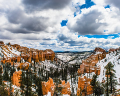 Bryce Canyon 7 (MarcCooper_1950) Tags: trees red sky orange snow colors clouds landscape utah nikon scenery rocks vivid canyon cliffs hills southern boulders hoodoo bryce rainfall hdr formations lightroom mounatins brycecanyonnationalpark geologic d810 marccooper