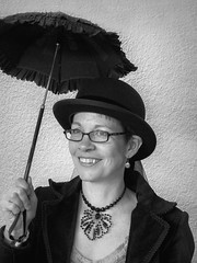 Steampunk Woman (J Wells S) Tags: ohio portrait people blackandwhite bw woman monochrome umbrella glasses costume cosplay cincinnati dressup parasol bowlerhat candidportrait blueash steampunkwoman 2014steampunkempiresymposium crowneplazamotel thepandorasociety