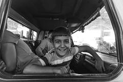 Street market :  Two children of a seller - one is hiding :) (Mustafa Karaoglu) Tags: smile children child laugh adana streetmarket