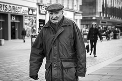 Stories Of Our Lives (Leanne Boulton) Tags: life street old city uk light shadow portrait people urban blackandwhite bw white man black cold detail male texture monochrome face look canon sadness 50mm mono scotland living blackwhite eyes eyecontact arm natural emotion humanity bokeh outdoor expression glasgow candid character culture streetphotography streetlife scene depthoffield human elderly shade portraiture 7d isolation aged feeling stories society tone facial amputee candidportrait candidstreetphotography candideyecontact