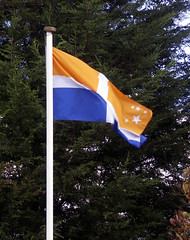 Scilly Flag (Badly Drawn Dad) Tags: blue orange white stars flag islesofscilly mybackgarden scilloniancross