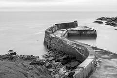 Collieston Pier - Scotland ([ Jaso ]) Tags: longexposure blackandwhite bw water lines wall coast scotland pier nikon aberdeenshire harbour filter northsea curve tamron 2470 collieston nd1000 sbend