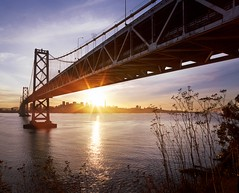 Sundown Bay Tranquility (RZ68) Tags: bridge sunset sky cliff sun reflection water skyline sunrise island dawn star oakland bay san francisco treasure angle no or under wide down calm velvia flare sunburst yerba provia buena rz67 e100