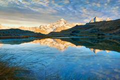 Morning in the Alps (Meleah Reardon) Tags: sunset mountain lake alps reflection nature beautiful clouds sunrise landscape photography switzerland pond europe swiss glory gorgeous illuminate reardon sunsrise meleah