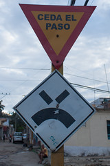 Angry Road Sign in Cuba (hectordotlee) Tags: road wood travel sign yellow vertical canon funny traffic outdoor cuba tourist angry trinidad local giveway funnysign 500d canon500d cedaelpaso sanctispritus