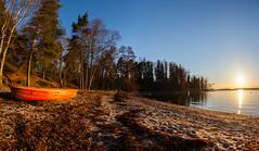 Late afternoon sun (Antti Tassberg) Tags: sunset red sea sun beach finland landscape prime boat spring helsinki sundown fisheye shore 15mm lauttasaari vene ranta auringonlasku aurinko uusimaa kevt laru