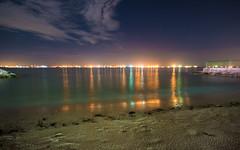 East Coast (arnabjosephite) Tags: ocean blue light sea sky people reflection beach yellow clouds port stars sand singapore ships