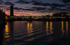 glint of Sevilla (mehdi_ziani) Tags: bridge light sunset sevilla seville reflet pont glint coucherdesoleil fleuve flexion