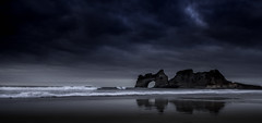 Storm's coming in (gray_nigel) Tags: storm rock waves arch tide refelection