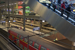 Hauptbanhof (micmol ) Tags: city bridge people woman man building berlin station horizontal architecture train germany subway de movement technology action crowd group perspective engineering indoor fromabove communication trainstation level commuter commuting lookingdown adults connection caucasian